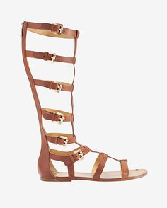 Belle by Sigerson Morrison Buckle Knee High Gladiator Flat Sandal: A chic knee high buckle detailed gladiator silhouette, offers instant glamour whilst injecting some serious fun into your look. Back heel zipper. Leather sole. In ...