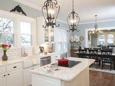 Gorgeous white kitchen by Chip and Joanna Gaines -- I love the farmhouse sink and subway tiling backsplash...