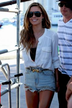 high waisted jean cut off shorts, a statement belt, unbuttoned white blouse with a black tank top