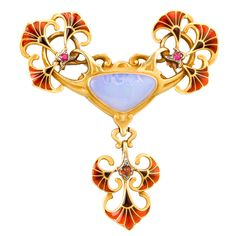 BOUCHERON Art Nouveau Opal Ruby Garnet Enamel Brooch | circa 1900 French Art Nouveau gold, ruby, garnet, white opal and enamel brooch by Boucheron. The 18-karat gold brooch features whiplash curves and foliate motifs decorated with cloissonné enamel and is accented by rubies, garnets and a triangular white opal center. 1stdibs.com