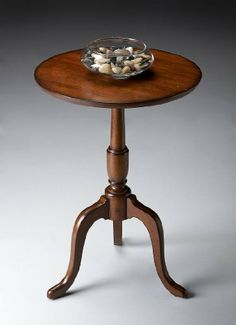 Butler Specialty 6023102 Round Accent End Table, Old World Cherry by Butler Specialty Company. $189.00. Physically distressed finish. Solid woods, Wood products and choice Cherry veneers. 18 in. Dia. x 26.5 in. H. Finish:Old World Cherry Round Accent Table Solid woods, wood products and choice cherry veneers. Physically distressed finish.