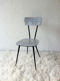 grey formica chair with chrome tube structure
