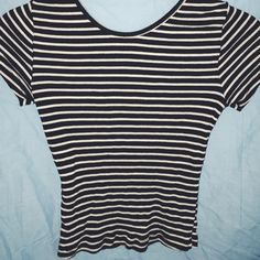 brandy melville crop top It's a black and white striped ribbed crop top! very adorable. its tight fitted and is 100% brandy but i cut the tag off do to itchiness Brandy Melville Tops Crop Tops