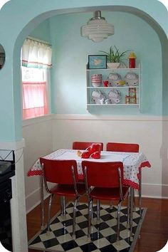 Aqua w cream beadboard, red furniture.  I like the beadboard a lot.