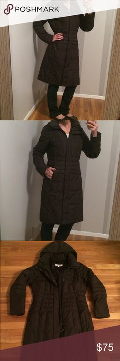Calvin Klein Long Winter Puffer Coat Great Condition!  Color: Dark Brown Very stylish, warm comfy winter coat! It comes to knee length, has hood, zipper,l and/or button up, 2 pockets on the outside & 3 hidden pockets on the inside.  **There's the slightest bit of dirt on the collar, I didn't even notice it until I thoroughly looked over the coat. Calvin Klein Jackets & Coats Puffers