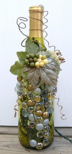 Decorative Embellished Wine Bottle Light with Leaves, Berries, and Gold Glass Gems. $20.00, via Etsy. by tammy