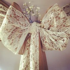 ivy dedorated chairs | Here is a sash shown with gypsophila added to the bow for extra effect ...