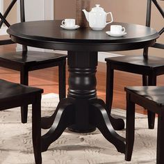 Enjoy Sunday brunches and family dinners at this classic dining table, showcasing a traditional pedestal design. Product: Dining table...