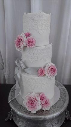 Classic, pink, white & grey with edible lace wedding cake. Contact Carina Sephton 0823005301. Area: Mpumalanga: Lydenburg, Dullstroom, Burgersfort, Nelspruit & Machadodorp.