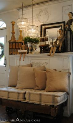 ♥ the seat display in front of the mantle...and doll legs dangling down.  And the chandeliers, of course!