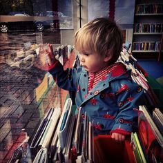 Look at this little nugget!  Who doesn't love a good book on a rainy day?