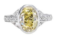 Ingle & Rhode bespoke VIntage engagement ring, set with an oval-cut 1.4ct fancy yellow diamond