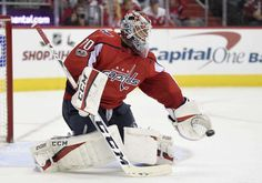 Washington Capitals goalie Braden Holtby (70) stops the puck during the second period of an NHL hockey game against the Calgary Flames, Monday, Nov. 20, 2017, in Washington. (AP Photo/Nick Wass)