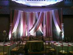 Beautiful stage- draping different fabrics and uplighting
