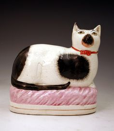 Victorian Staffordshire pottery figure of a recumbant cat mid 19thc.