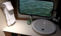 Cruisers Yachts 390 Express Coupe: The starboard side head has a large window -- one of eight in the 390's hull side.