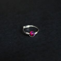 This listing is for one of the sterling silver rings with Opal bead detail. Suitable for anywhere you wear thinner jewellery (ear and nose would be the best places) These are roughly 0.7mm x 8mm Made from sterling silver with lab created Opals Please ask if you have any questions