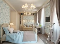 In the master bedroom suite, feminine fleur-de-lis wallpaper in powder blue freshens cream furniture and trims, along with matching blue bed...