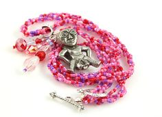 Rose and lilac Sheela-na-gig fertility necklace: https://www.etsy.com/listing/115177027/rose-and-lilac-sheela-na-gig-fertility
