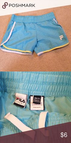 Girls blue basketball shorts These are perfect for playing sports, gymnastics, any outdoor or athletic activities! They have no holes or stains! They come from a smoke free but pet friendly environment! I ship Monday-Friday! I don't hold or trade. I don't negotiate the price in the comments. I only sell through poshmark. The price is firm. Fila Bottoms Shorts