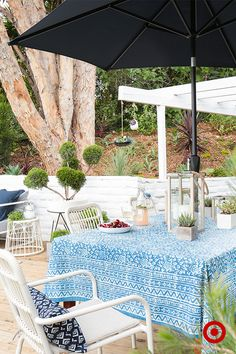 Target Home Style Expert Emily Henderon's patio is pure perfection. For effortless entertaining, cover an outdoor table with vintage fabric for a casual-chic tablecloth. Add small plants and candles to the tabletop to make the space more inviting. Scatter small bowls of snacks around for guests to graze on.