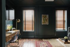 The opposing room on the third floor is the ying to the master suite yang. Instead of a white, airy room, the walls are painted in a dark, romantic Benjamin Moore Narragansett Green.