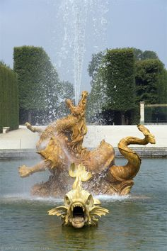Dragon Fountain in the gardens of the Versailles Palace near Paris