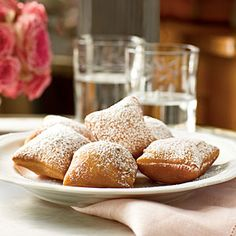 Beignets! You will never look at plain American donuts again, after eating this babies <3 melt down chocolate chips and a little bit of cream over a double boiler for a quick ganache dip, have some fruit syrup next to that, and CHOW. DOWN. <3