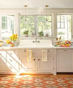 There is something about an old salvaged kitchen sink that makes the space feel even more homey. Combined with some warm accents, the sink's beautiful design becomes the focal point of the kitchen. #kitchen #design #sink