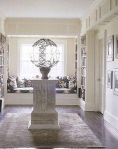 Ikat print banquette in armillary room | Elle Décor