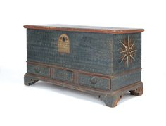 """Pennsylvania pine dower chest, 18th c., retaining a 19th c. decorated surface, 29"""" h., 48"""" w."""
