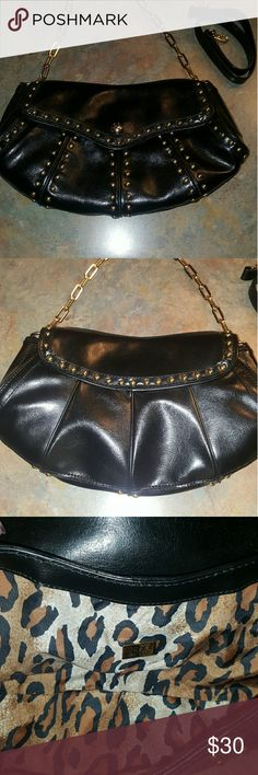 """MAXX NEW YORK PURSE - NWOT This purse is new,  from a pet & smoke free home. It has a """" tarnish free """" gold strap that is removable & a black leather strap as well. Silk Leopard print lining. No stains, scratches or tares. MAXX NEW YORK  Bags"""