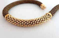 A perfect gift: a beaded rope jewel, a Statement necklace made of beautiful frosted bronze and golden beads. A gorgeous jewel for all the lovers of warm colors. I created this beaded necklace crocheting a chain of 7 Japanese Toho beads, size 8/0, with brown lisle according to the tubular