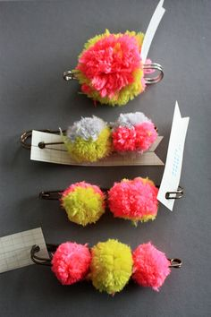 fluorescent pom pom brooches.