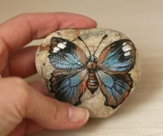 Stone with a hand-painted butterfly by SkadiaArt on Etsy