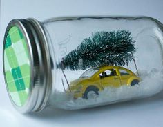 "Mason jar snow globe. HA! The car inside makes me think of the movie ""Christmas Vacation"". It would be cute to find an old diecast car that resembles the ""Family Truckster"" and style the inside with some quote or picture from the movie. Cute gift for your friends with a sense of humor!"