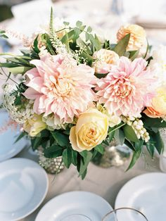 Pink Dahlias may be our new favorite wedding centerpiece!   See the wedding on SMP: http://www.StyleMePretty.com/2014/02/26/elegant-del-mar-garden-wedding/ Photography: Ashley Kelemen