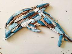 Painted driftwood dolphin by mermaidsmasterpiece on etsy: Www.etsy.com/shop/mermaidsmasterpiece