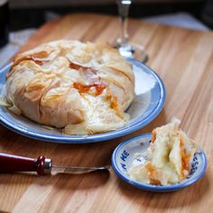 baked apricot brie - brie 8-10 sheets phyllo, 1 1/2 T butter,melted, 3-4 T any jam