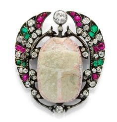 An Antique Egyptian Style Scarab Brooch with Emeralds, Rubies and Diamonds, circa 1870.