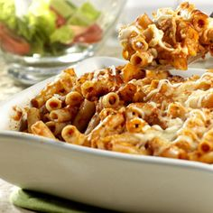 Short tube-shaped pasta tossed with seasoned tomato sauce, mozzarella and Parmesan cheeses is baked in a casserole until bubbling.