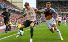 Manchester United's Victor Lindelof holds off the challenge from Burnley's Jeff Hendrick during the Premier League match between Burnley FC and Manchester United at Turf Moor on September 2018 in. Burnley Fc, Premier League Matches, Manchester United, Hold On, Challenges, The Unit, Man United, Naruto Sad