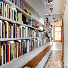 23 Bookcases To Lust Over — & Copy Immediately #refinery29 http://www.refinery29.com/best-bookcase-decorating-ideas#slide-21 That long, awkward hallway now has a purpose.