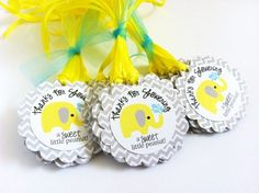 Little Peanut Baby Elephant Favor Tags in Yellow, Gray and Chevron | adorebynat   These elephant favor tags are so cute and perfect for a neutral baby shower party! The yellow elephant with gray stripe ear playing with water is so cute. Each gift tag has a fun phrase that says Thanks for Showering a Sweet Little Peanut! I use Chevron pattern in grey as the background which certainly makes this tag adorable. Whimsical! Elephant is such a popular theme for a baby shower party.