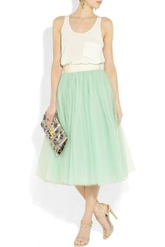 bridesmaid in mint tulle. But dark purple. Would be so pretty with a lace gown