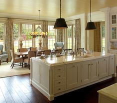 The space is awash with light that spills in from the windows and French doors that encircle the dining table.