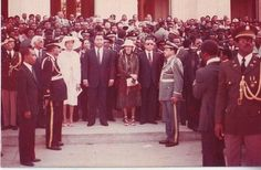 Haiti in the 1980s, at the height of elite decadence. Jean-Claude Duvalier with First Lady Michèle Duvalier and mother-in-law Simone Ovide Duvalier outside the steps of Haiti's National Palace.