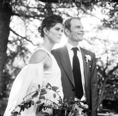 Photo by http://www.amaranthweddingphotography.com/ Arizona wedding, tom ford suit, groom, DKNY dress, custom made bridal cape, black and white film