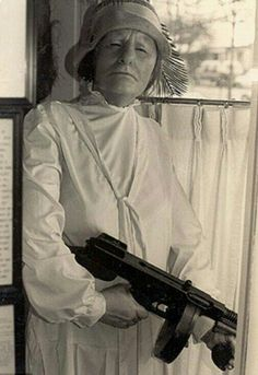 It an old photo the #legendaryUSBandit ,  Mrs. #MaBarker with her Thompson Sub Machine Gun.