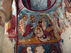 """A larger synthesis of frescos which completely cover the walls of Elmali Kilise(church); in the center is depicted the resurrection of Lazarus and in the right hand side the """"Palm Sunday"""" theme. All over the frescos according to the byzantine tradition of iconography greek inscriptions explain what is depicted. Elmali church, Cappadocia, Turkey."""
